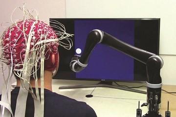 mind-controlled-robotic-arm-900x600.jpg