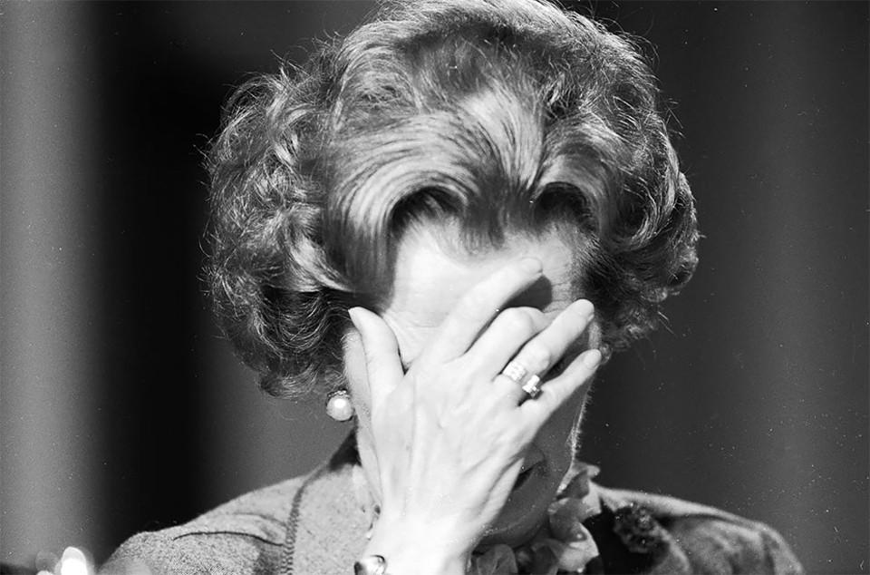British prime minister Margaret Thatcher covering
