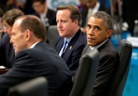 us_president_barack_obama_r_sits_alongside_prime_m