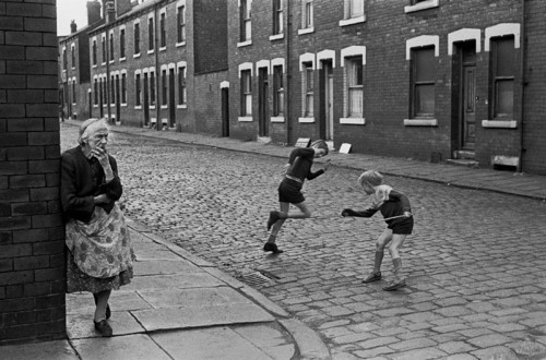 Elderly-lady-standing-at-her-street-corner-back-to