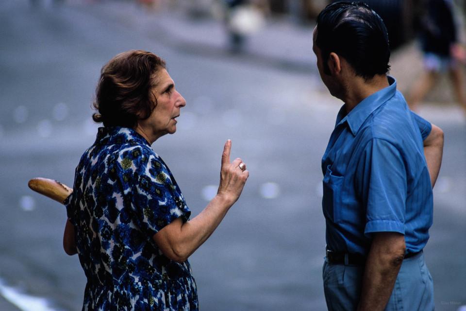 Woman with Bread Talking to Man, Paris.jpg