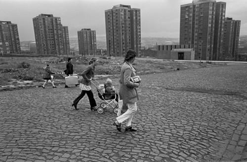 Families-wlking-across-slum-clearance-site-Newcast