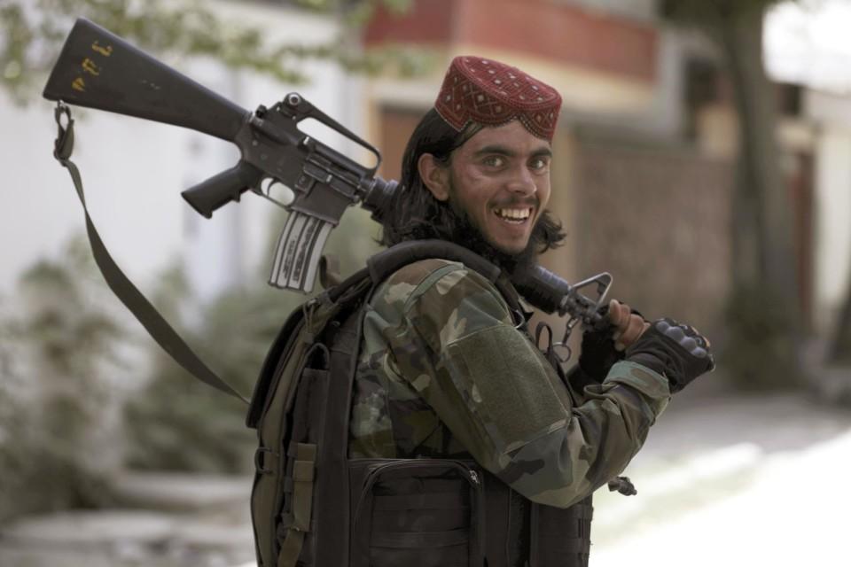 A Taliban fighter patrols in Wazir Akbar Khan in t