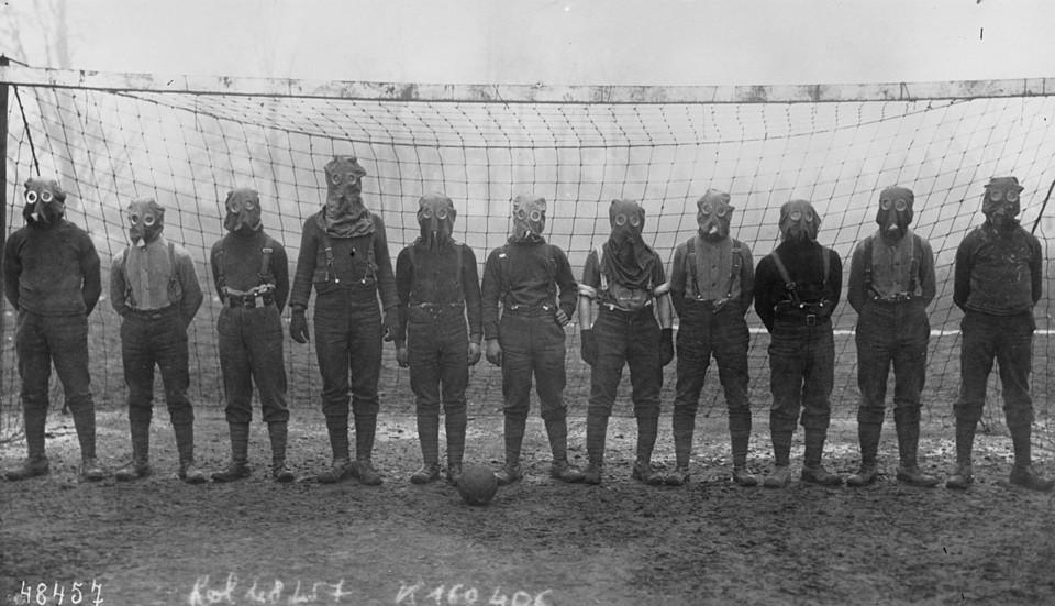 British_soccer_team_with_gas_masks,_1916.jpg