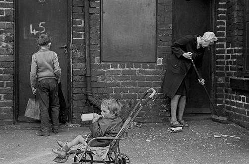 Mrs Tandy cleaning her backyard, Sheffield, 1969 -