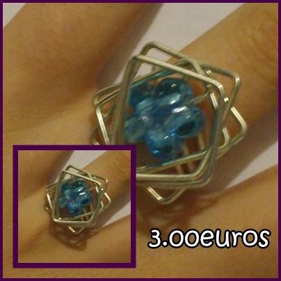 anel com flor azul. tamanho pequeno\médio