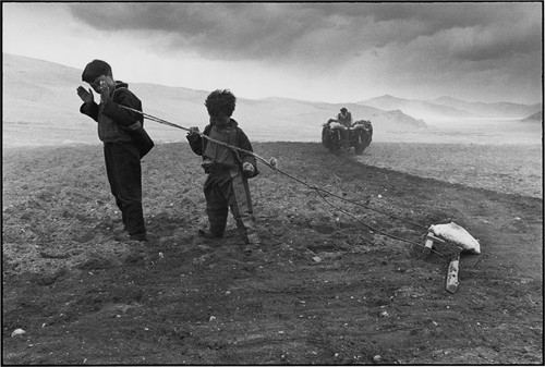 Himalaya Mountains. 2001. Family working in dust s
