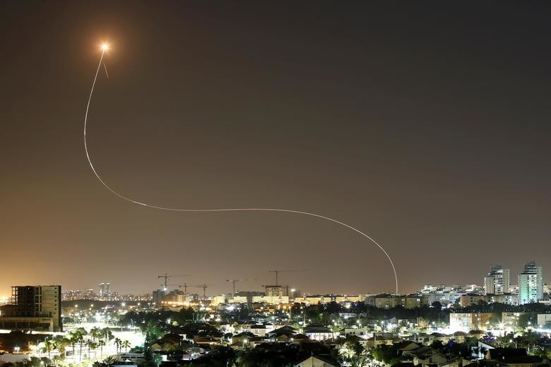 A streak of light is seen as Israel's Iron Dome an