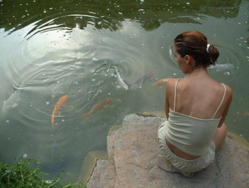 Girl and Koi Fish - Sandra V