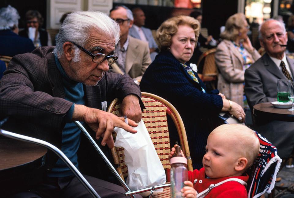 Old man with baby at café, Paris.jpg