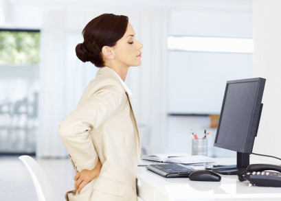 woman-at-desk-with-back-pain.jpg