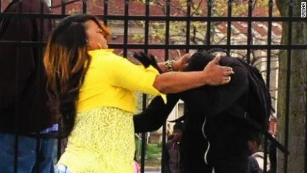 150428083936-baltimore-mom-slaps-rioting-son-large