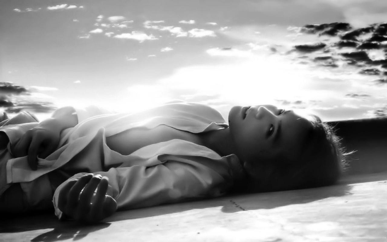 a-woman-laying-in-the-sun.jpg