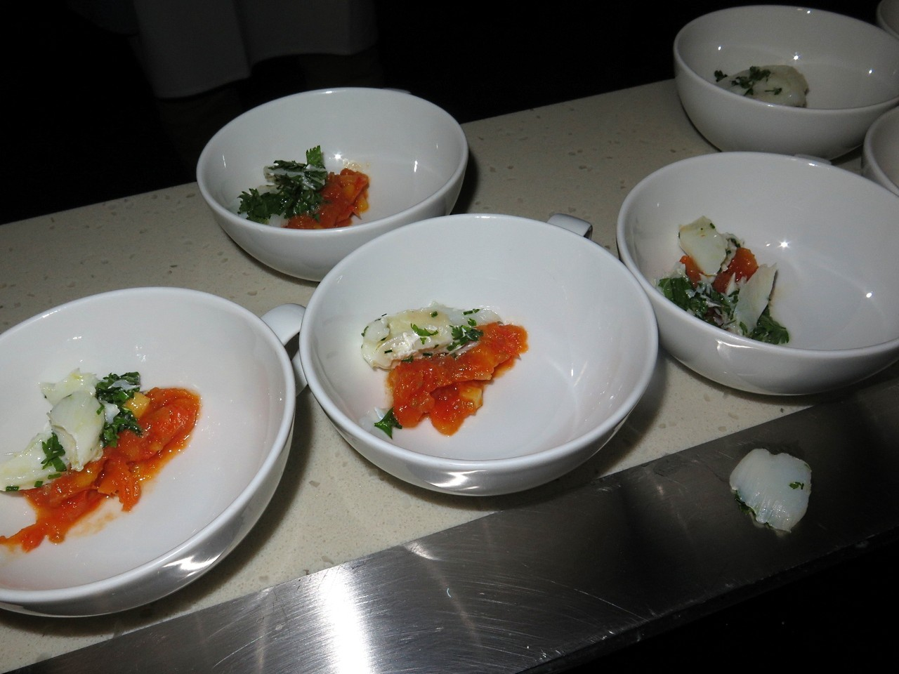 Foie gras with green curry, tomato jam, diced mango, cod petals