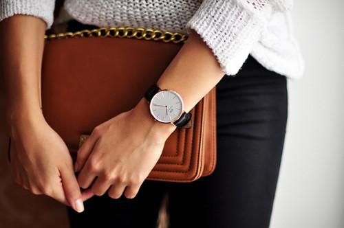 clock tan bag black jeans.jpg