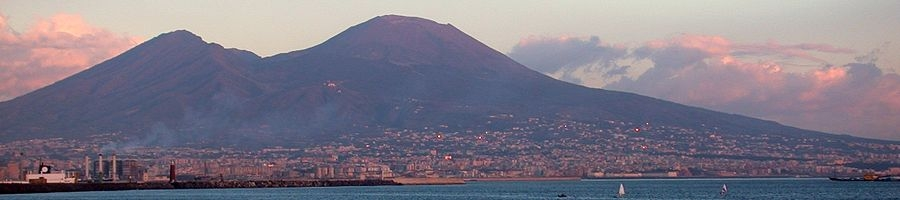 City of Naples with Mount Vesuvius at sunset. In w