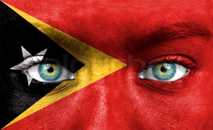5117505-human-face-painted-with-flag-of-east-timor
