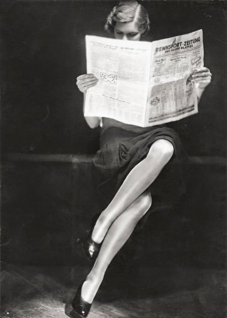A lady reading newspaper, 1932.jpg
